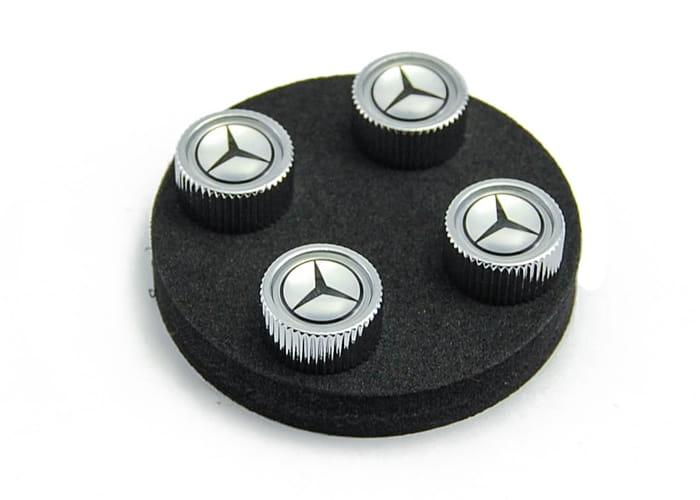 Mercedes benz star valve stem caps q6408128 genuine for Silver star mercedes benz parts